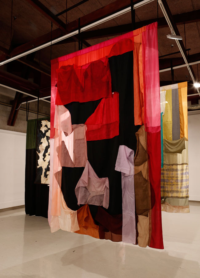 Emma Fitts, Fit-Out for Olivia Spencer Bower, 2015, silk, denim, oilskin, linen, grass matting, ceramic, sheepskin. Installation, Ilam Gallery, Christchurch. Photo courtesy of Daegan Wells